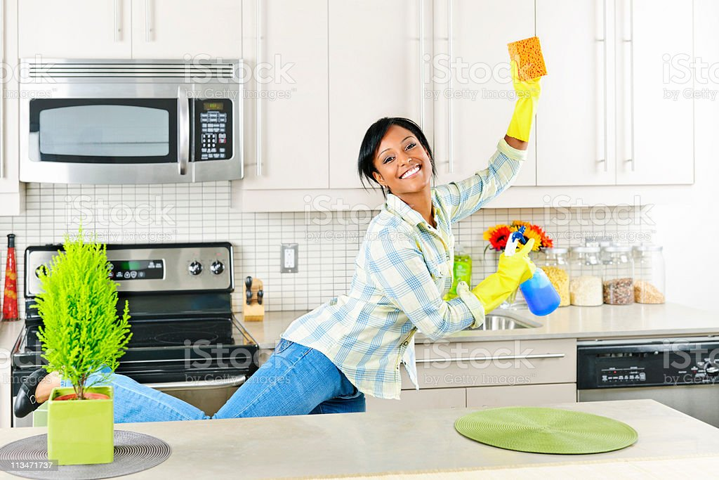 Young woman cleaning kitchen royalty-free stock photo