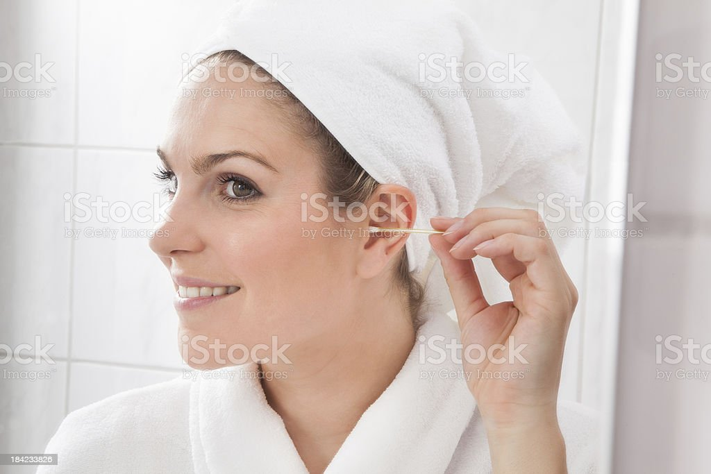 Young Woman Cleaning The Ear stock photo