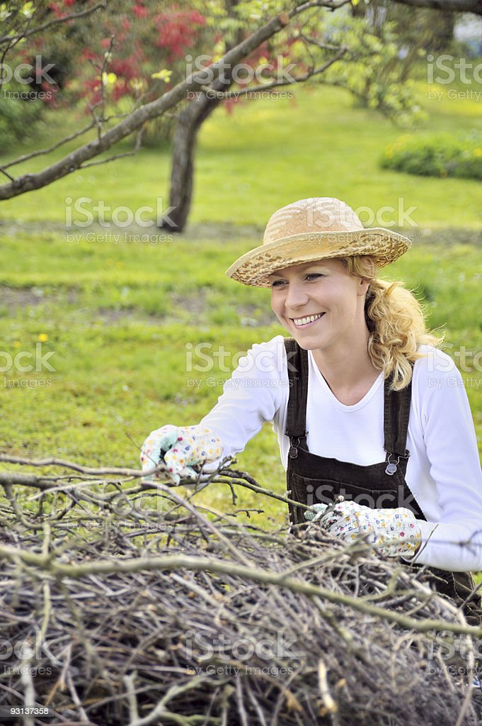 Young woman cleaning tree limbs royalty-free stock photo