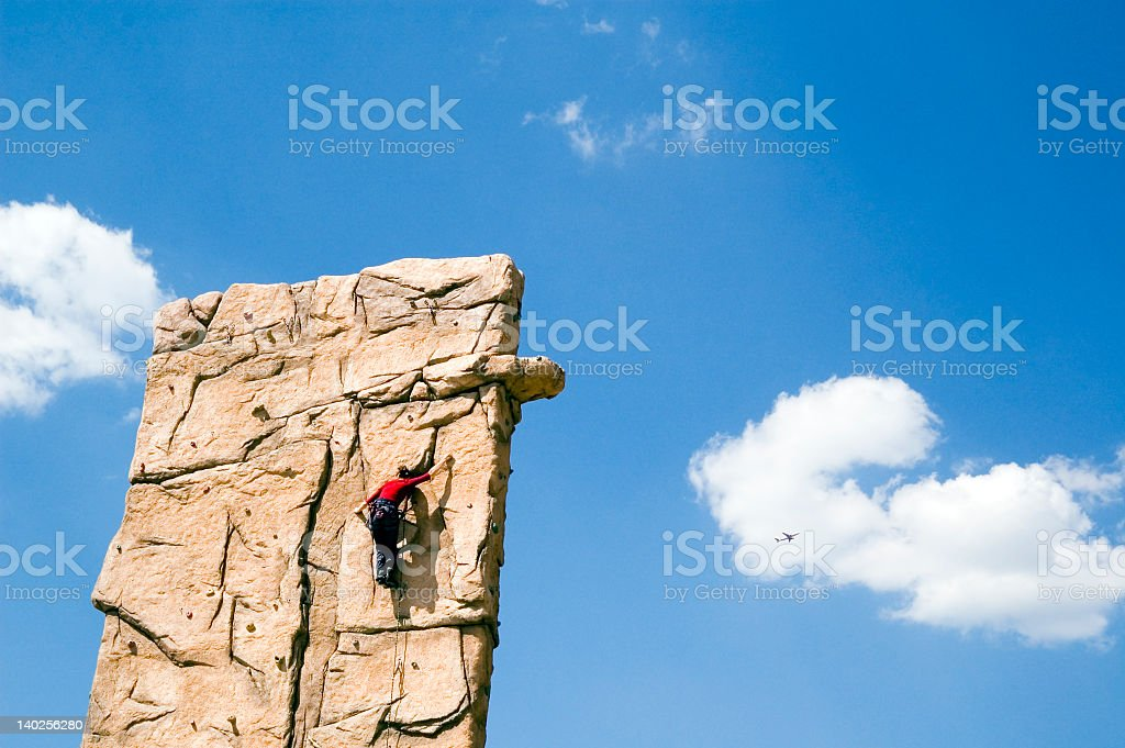 Young woman climb wall royalty-free stock photo