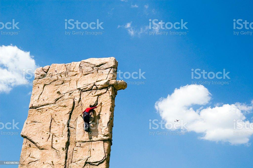 Young woman climb wall stock photo