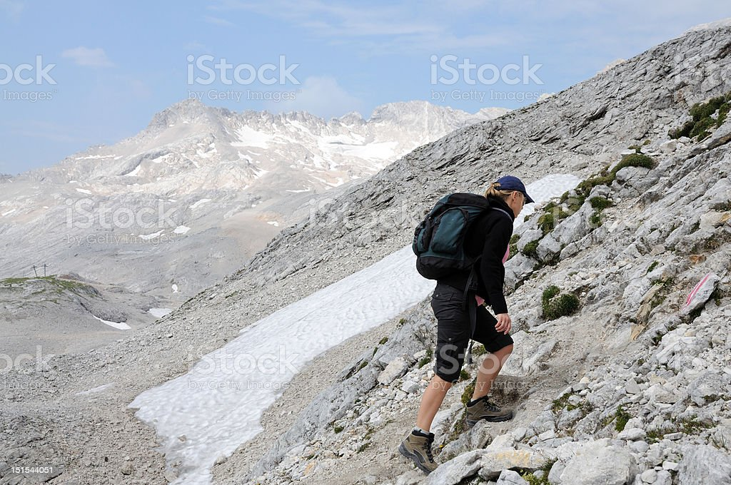 Young woman climbing in the mountains royalty-free stock photo