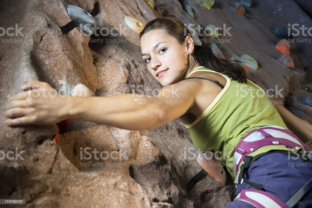 Young woman climbing rock royalty-free stock photo