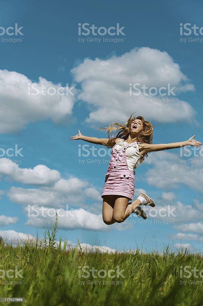 young woman close-up jumping stock photo