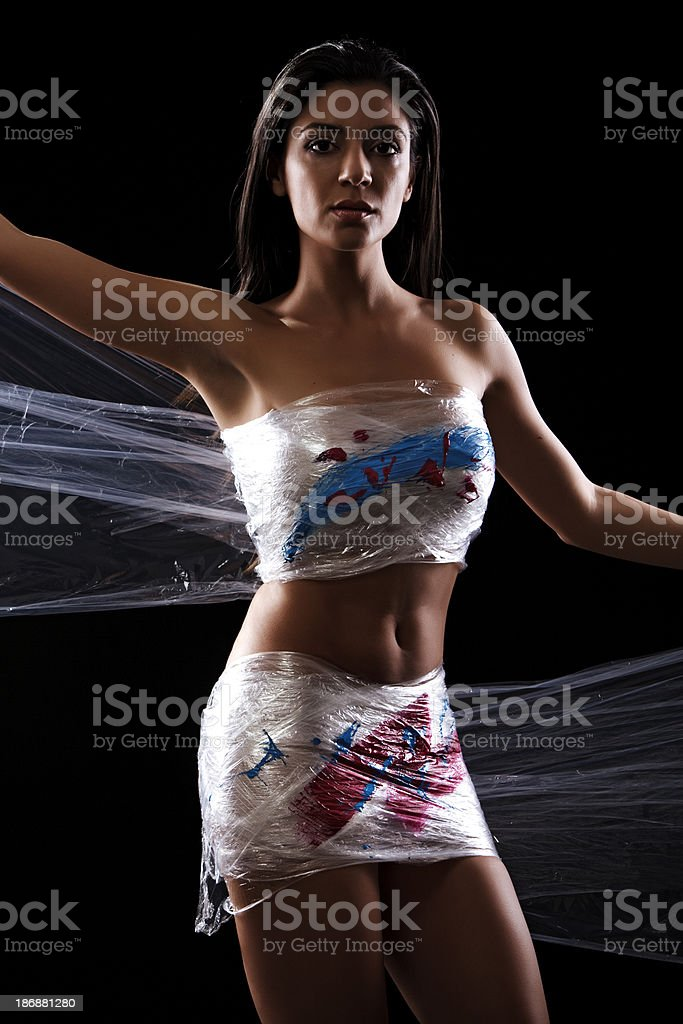 Young Woman clothed in Cling Film stock photo