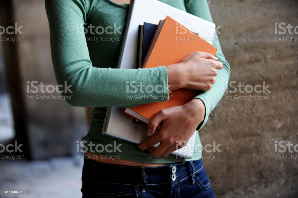 Young Woman College Student Holding Books and Computer stock photo