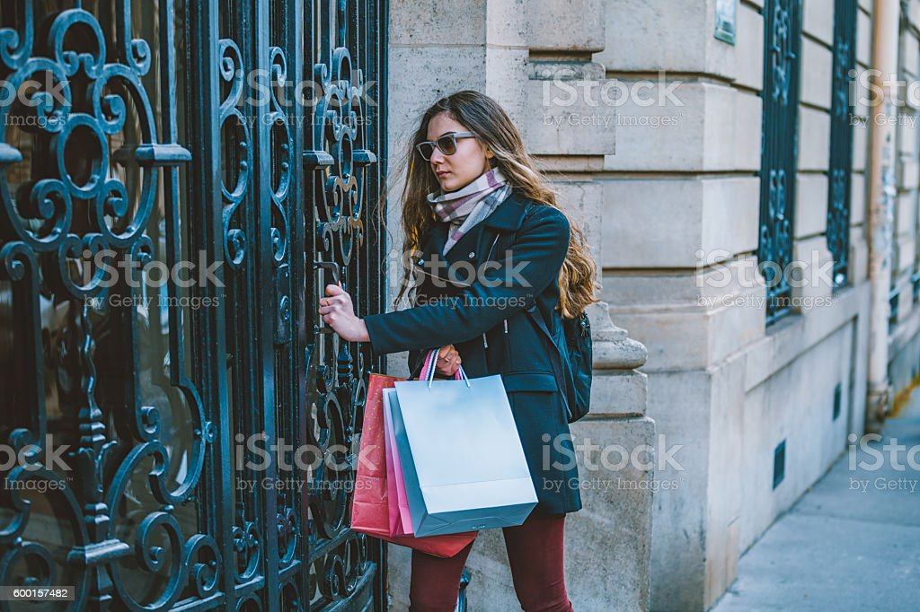Young woman comes home from shopping stock photo