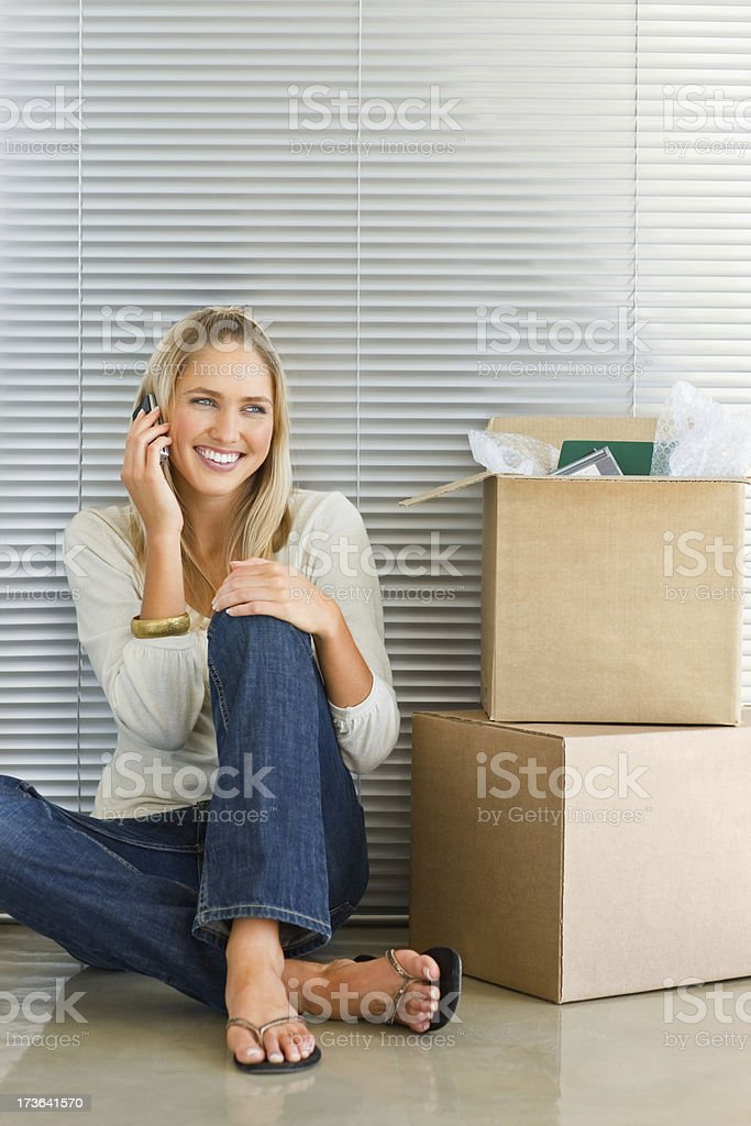 Young woman communicating on the mobile phone royalty-free stock photo