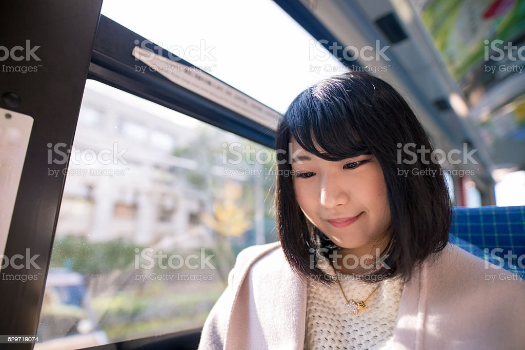 Young woman commuting on bus in the morning stock photo