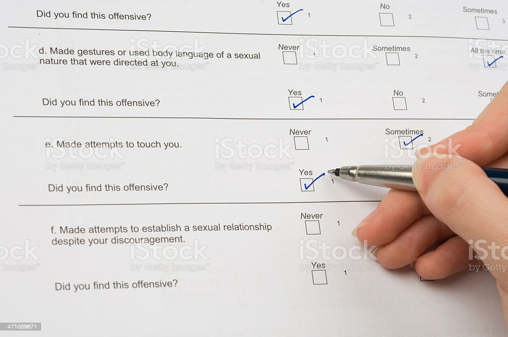 Young woman completing a Sexual Harassment Survey form stock photo