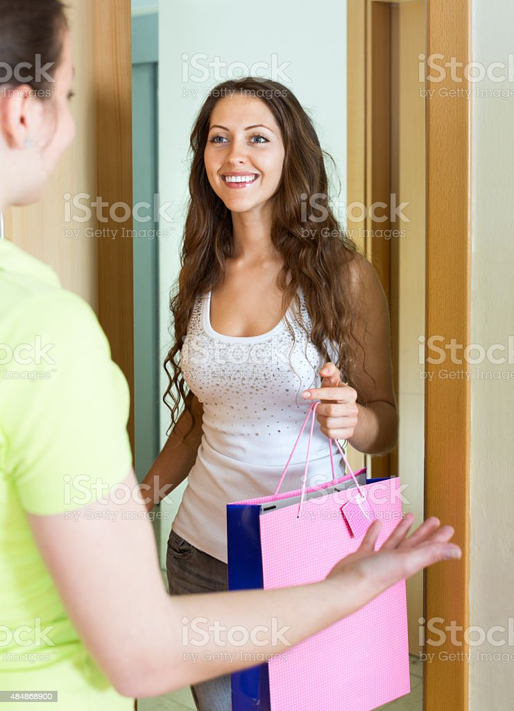 Young woman congratulating her friend stock photo