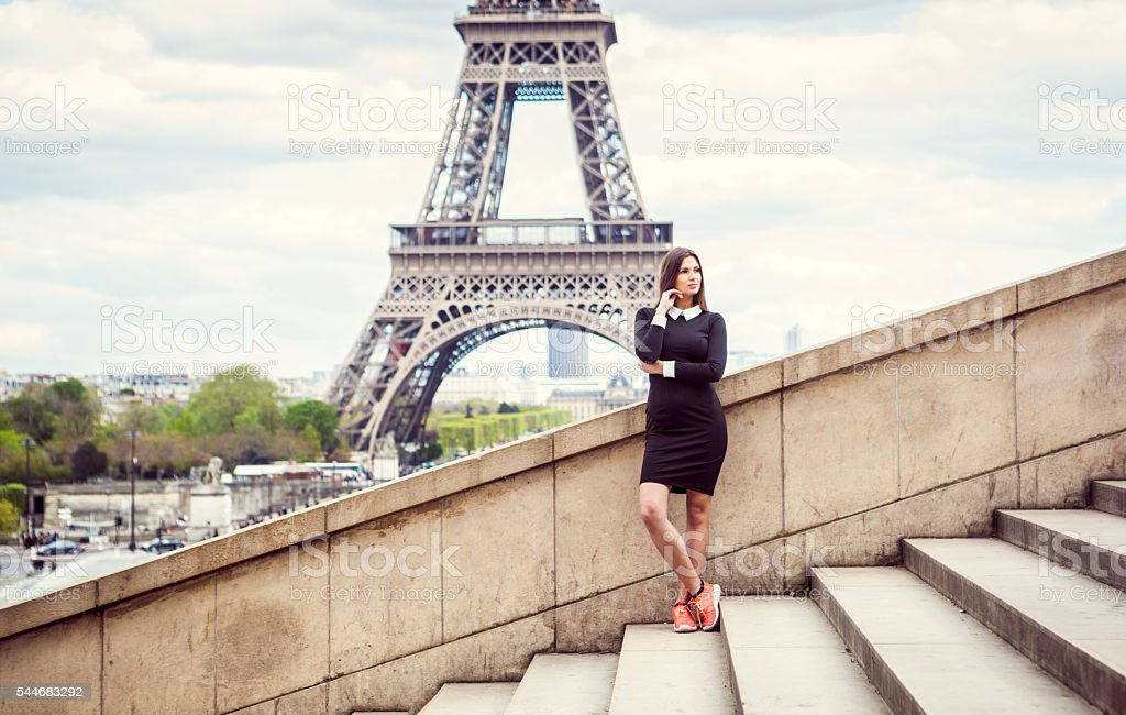 Young Woman Contemplating By The Famous Landmark stock photo