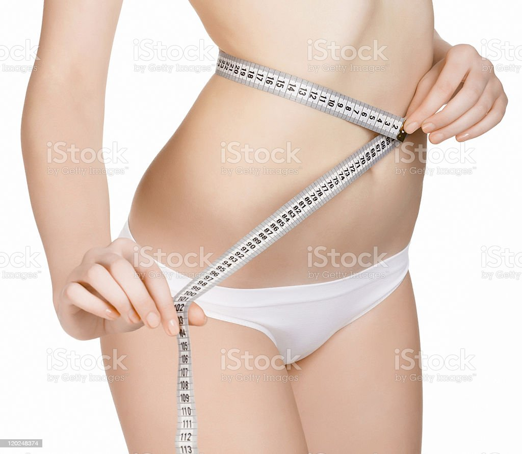 young woman controls her waist royalty-free stock photo