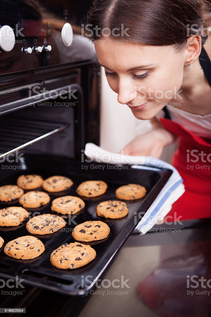 Young woman cooking cookies stock photo