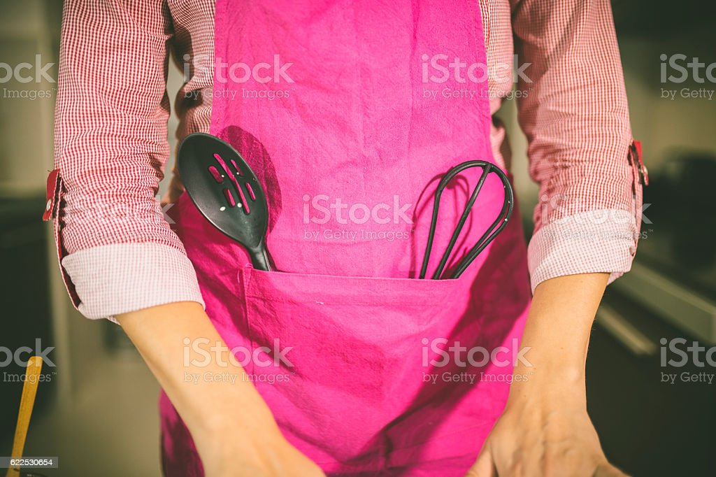 Young Woman Cooking in the kitchen. stock photo