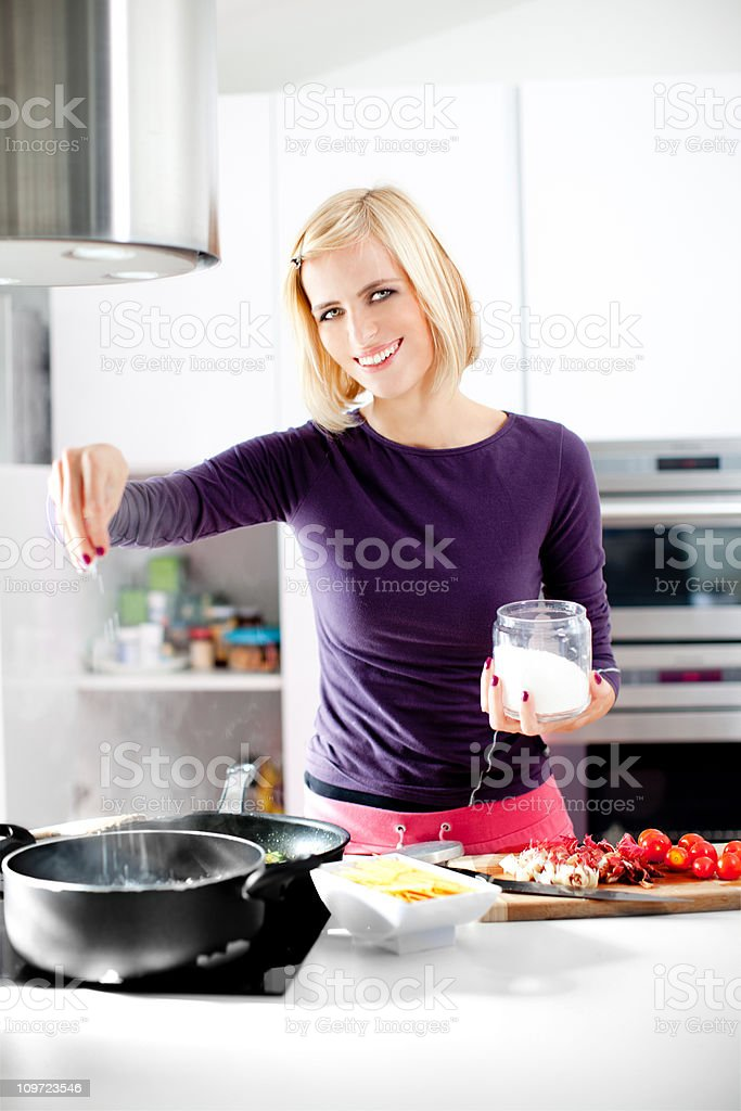 Young woman cooking royalty-free stock photo