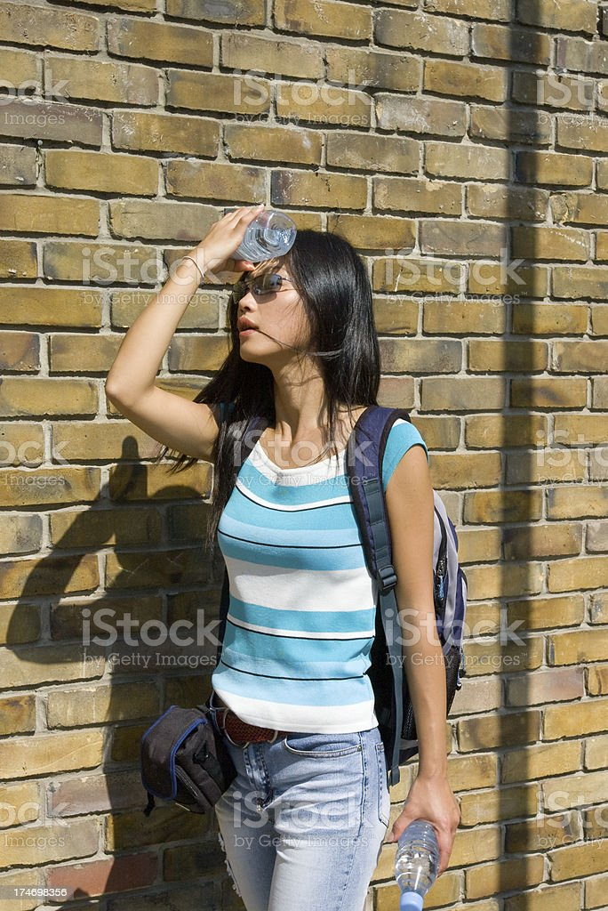 young woman cooling down in hot sun stock photo