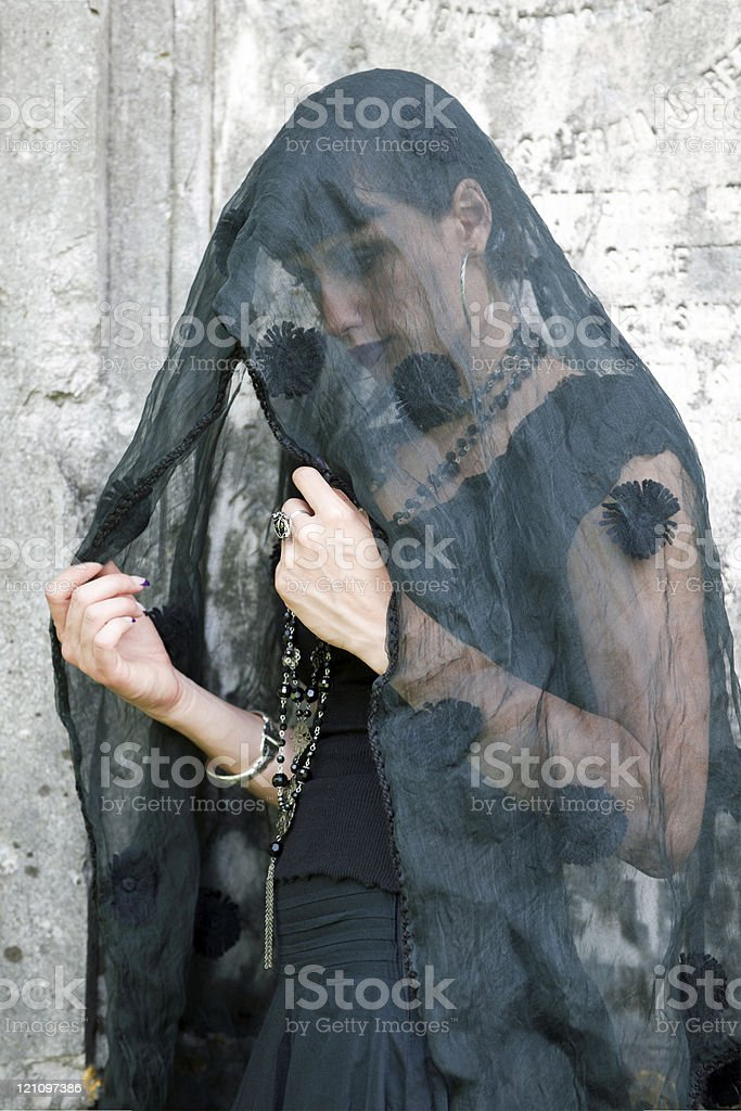 Young Woman Covered in Black Veil royalty-free stock photo