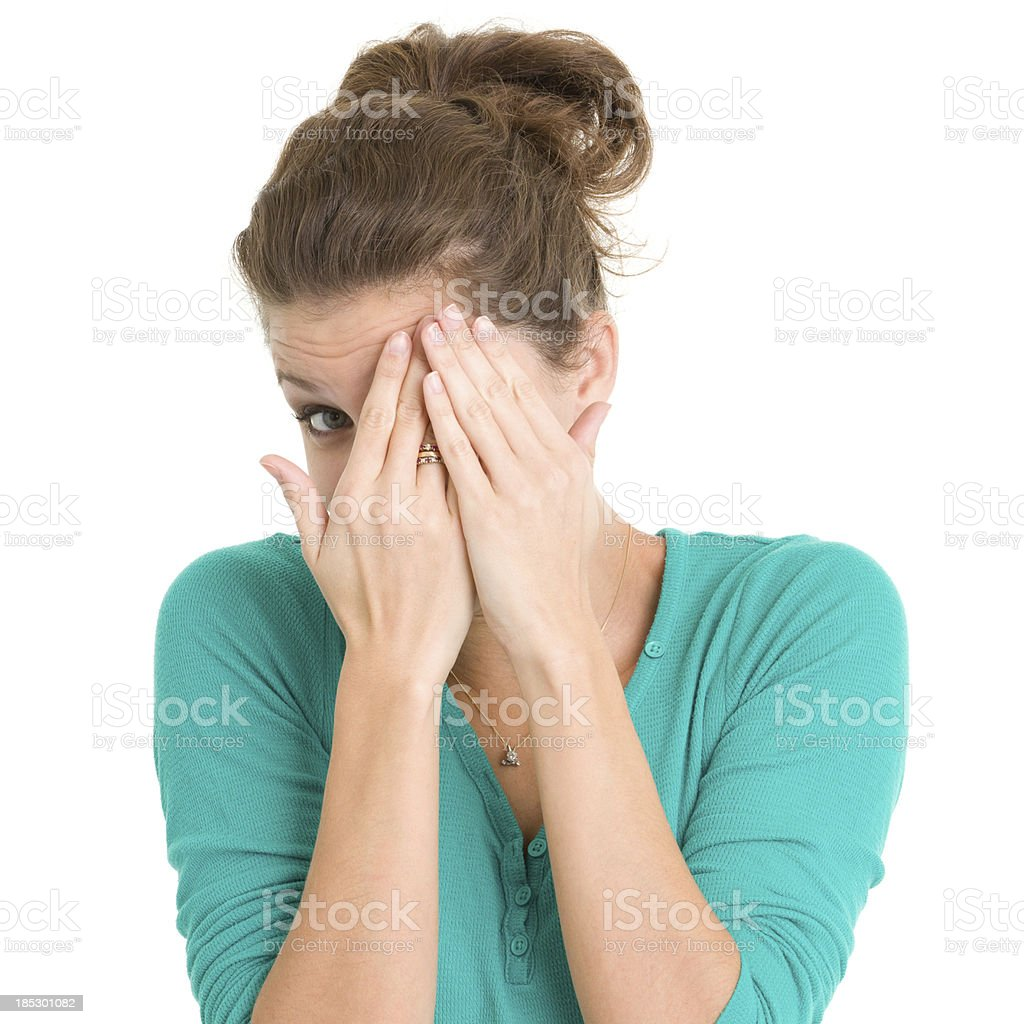 Young Woman Covering Eyes and Peeking stock photo