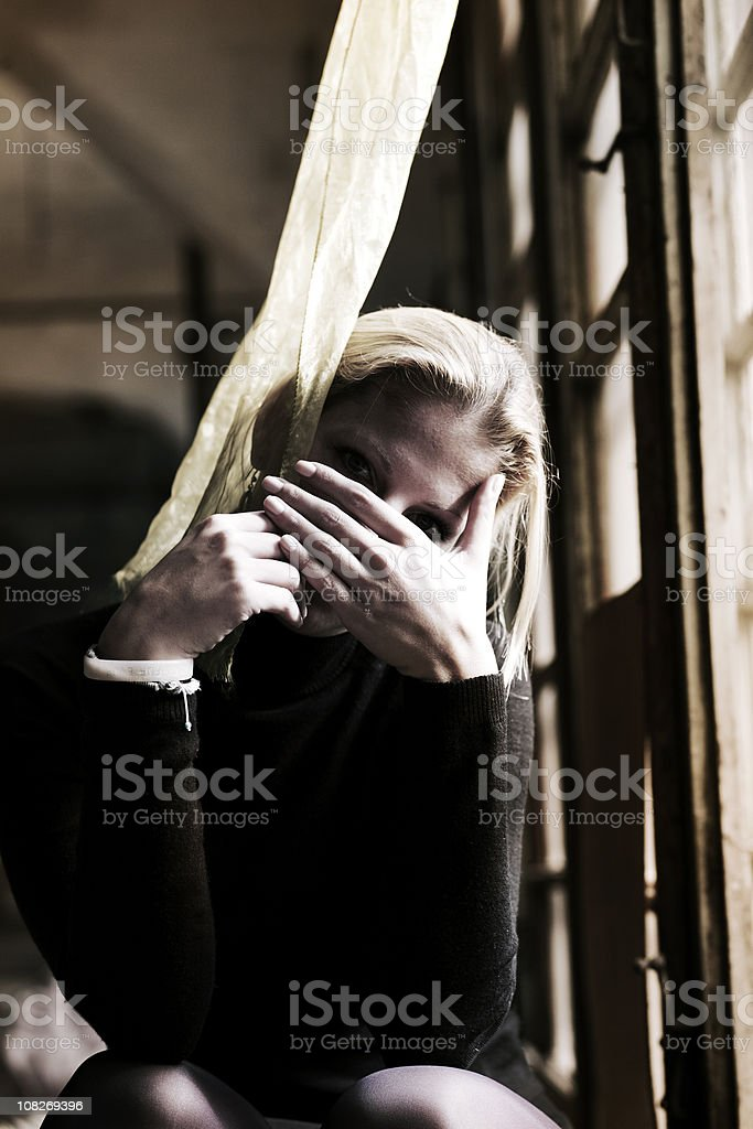 Young Woman Covering Face with hand royalty-free stock photo