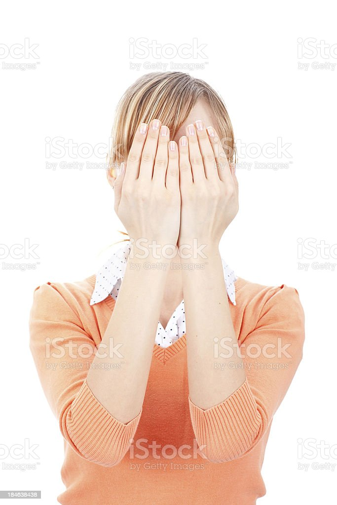 Young woman covering face with her arms royalty-free stock photo