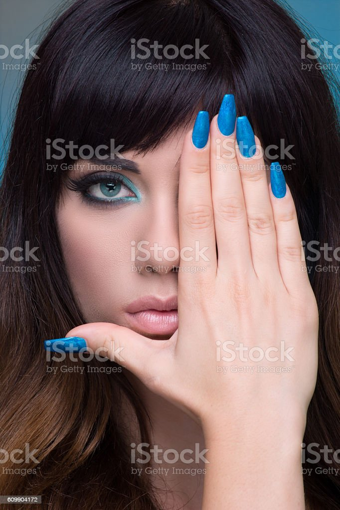Young woman covering half face stock photo