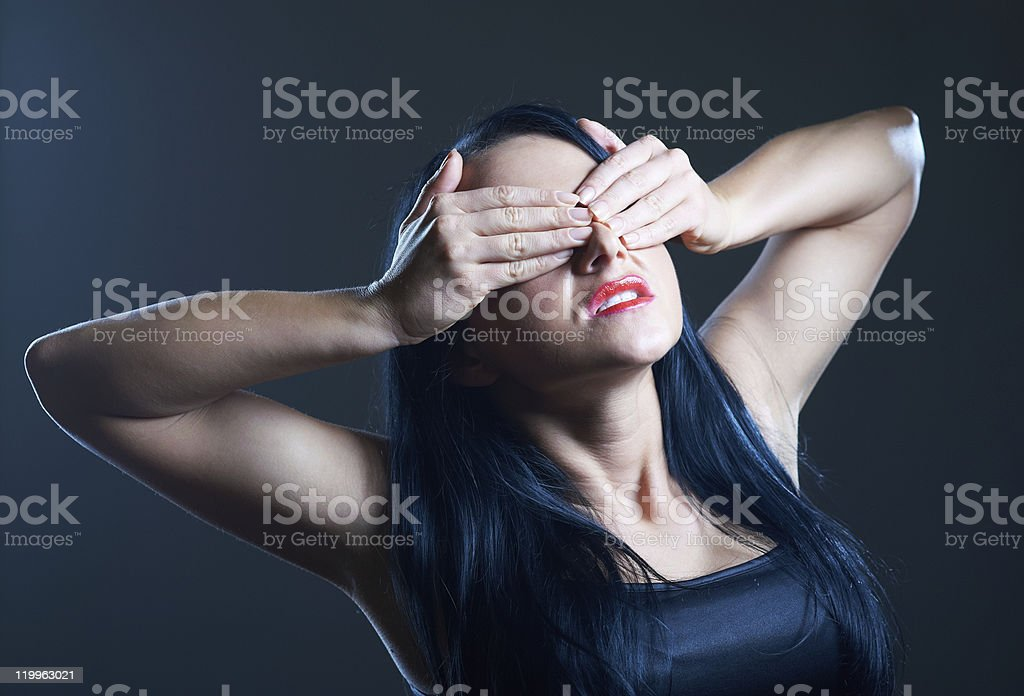 Young woman covering her eyes royalty-free stock photo