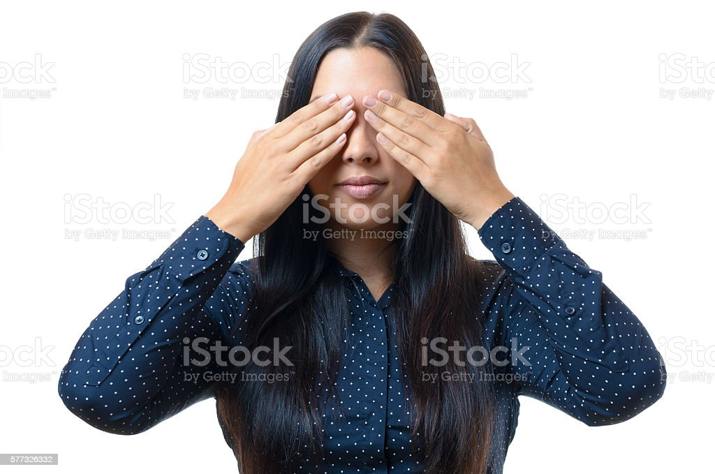 Young woman covering her eyes with her hands stock photo