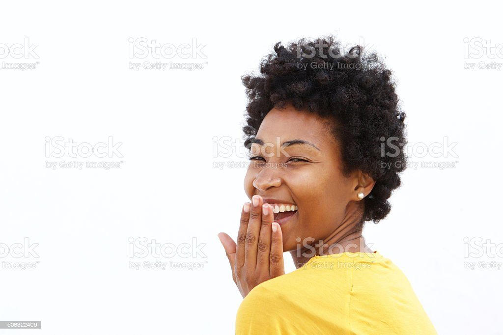 Young woman covering her mouth and laughing stock photo
