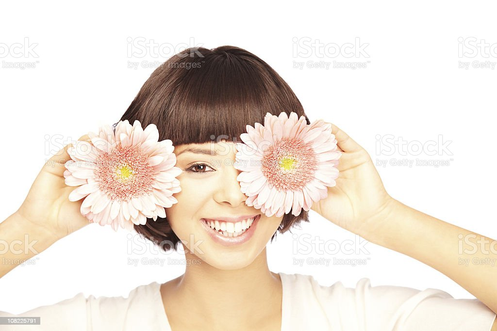 Young Woman Covering One Eye with Flower, On White Background royalty-free stock photo