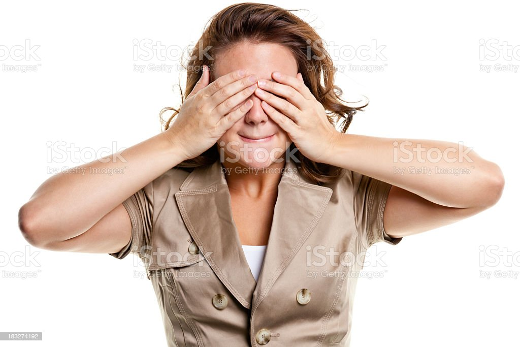 Young Woman Covers Eyes With Hands stock photo