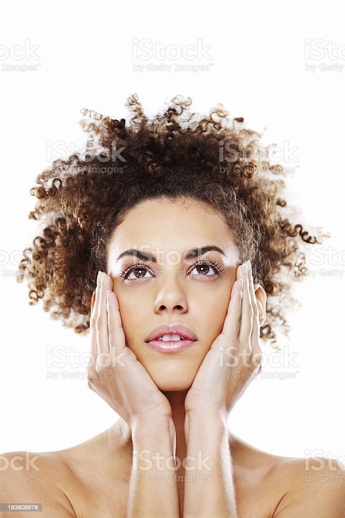 Young Woman Cradling Her Face stock photo