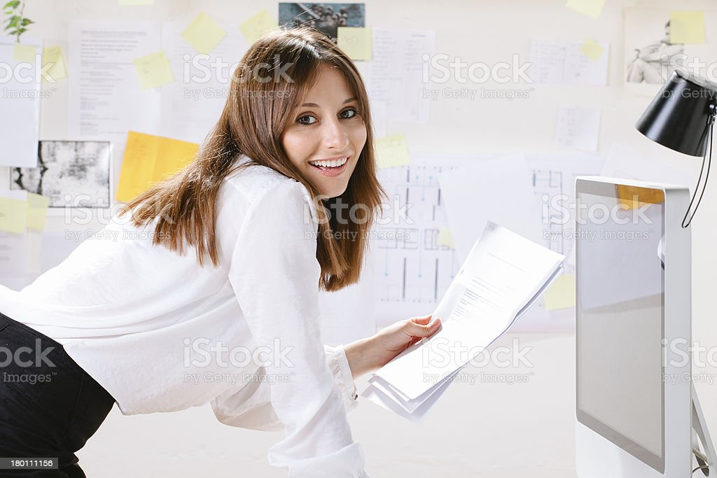 Young woman creative designer with documents working in office. royalty-free stock photo