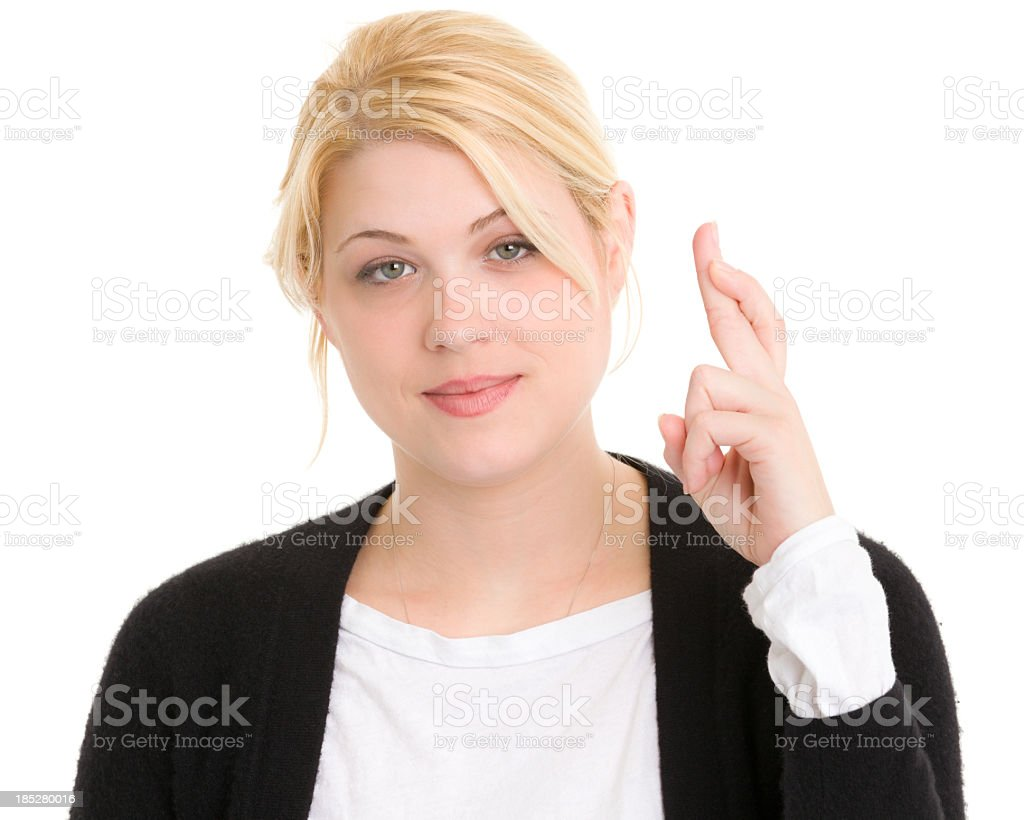 Young Woman Crosses Fingers royalty-free stock photo