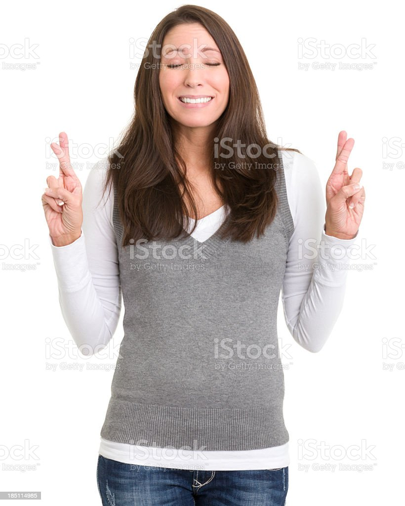 Young Woman Crosses Fingers Wishing stock photo