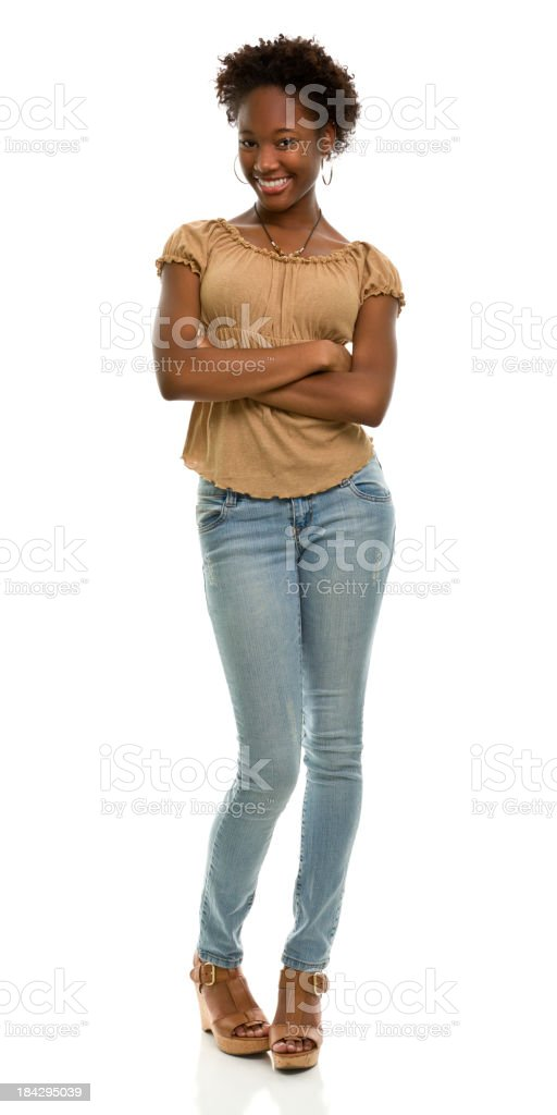 Young woman crossing arms in full length portrait stock photo
