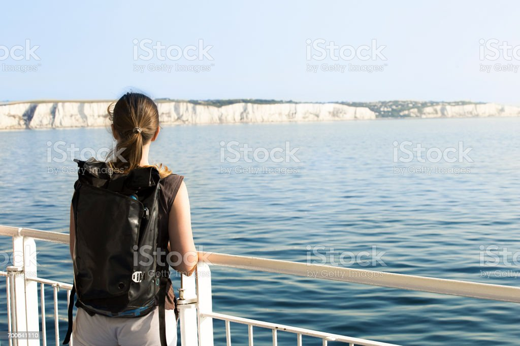 Young woman crossing English Channel by ferry stock photo