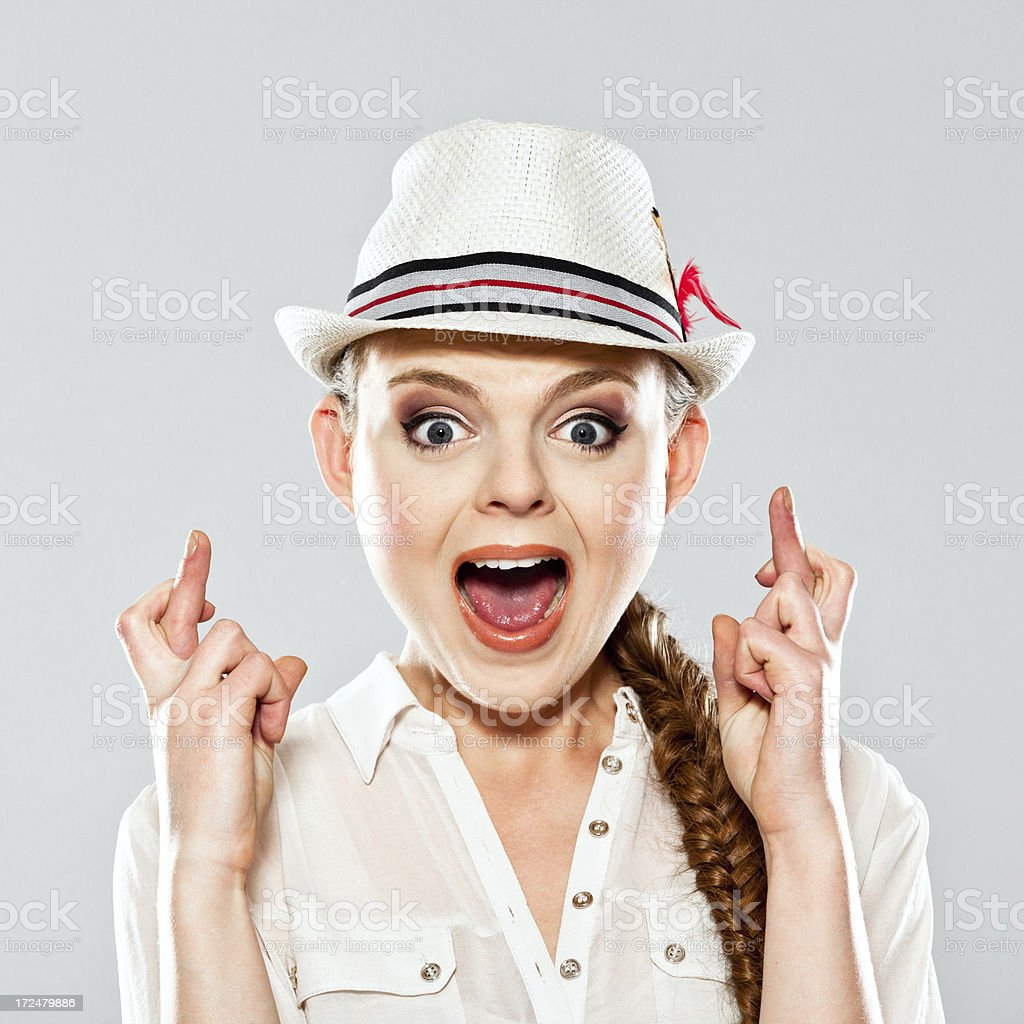 Young woman crossing fingers royalty-free stock photo