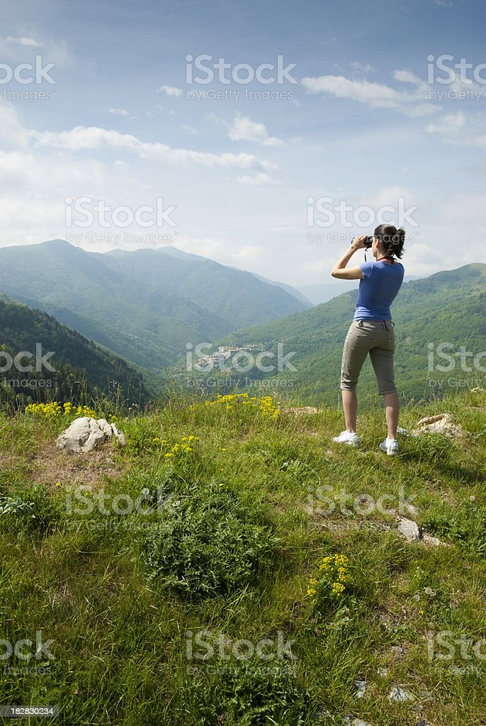 Young woman crowns the horizon royalty-free stock photo