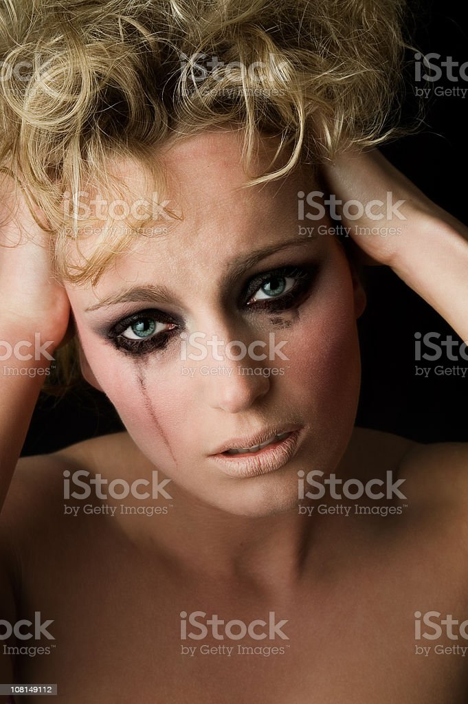 Young Woman Crying with Mascara stock photo