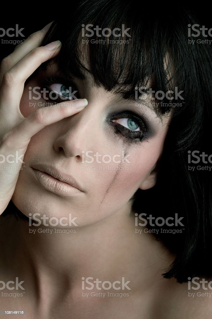 Young Woman Crying with Mascara Running royalty-free stock photo