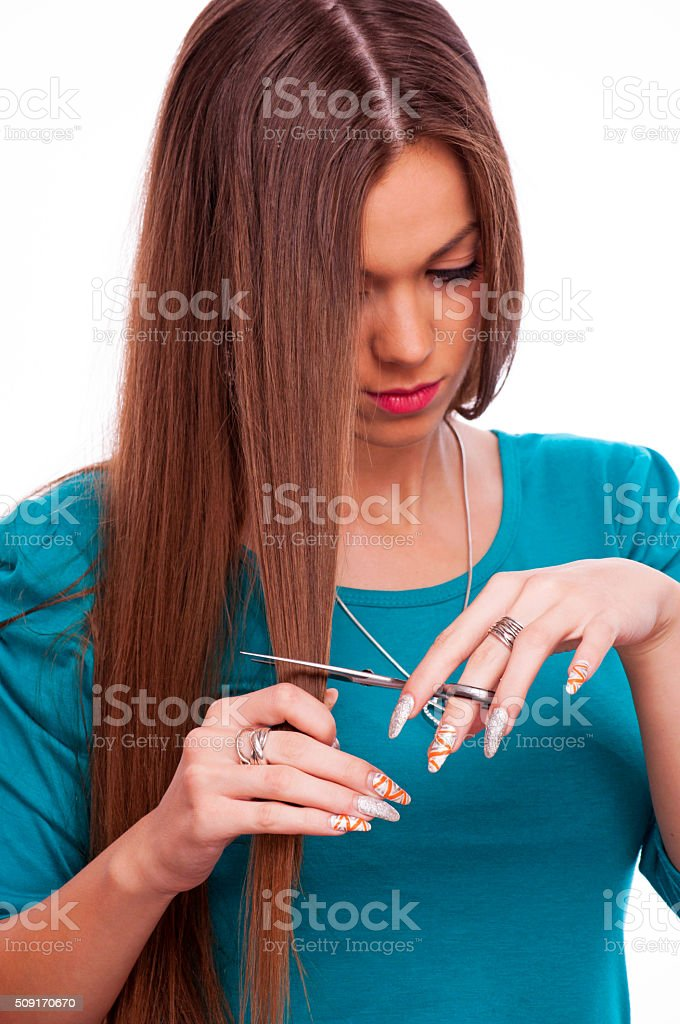 Young woman cutting her hair stock photo