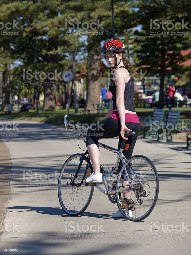 Young woman cycling by the beach royalty-free stock photo