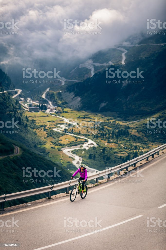 Young Woman Cycling stock photo