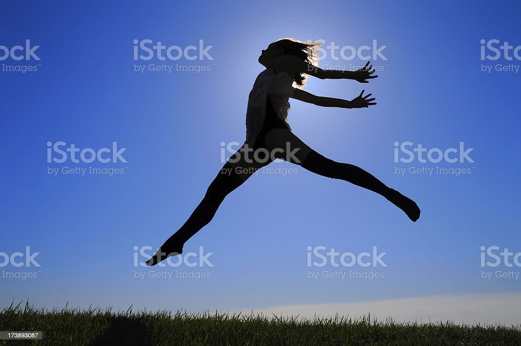 Young Woman Dancing and Jumping royalty-free stock photo