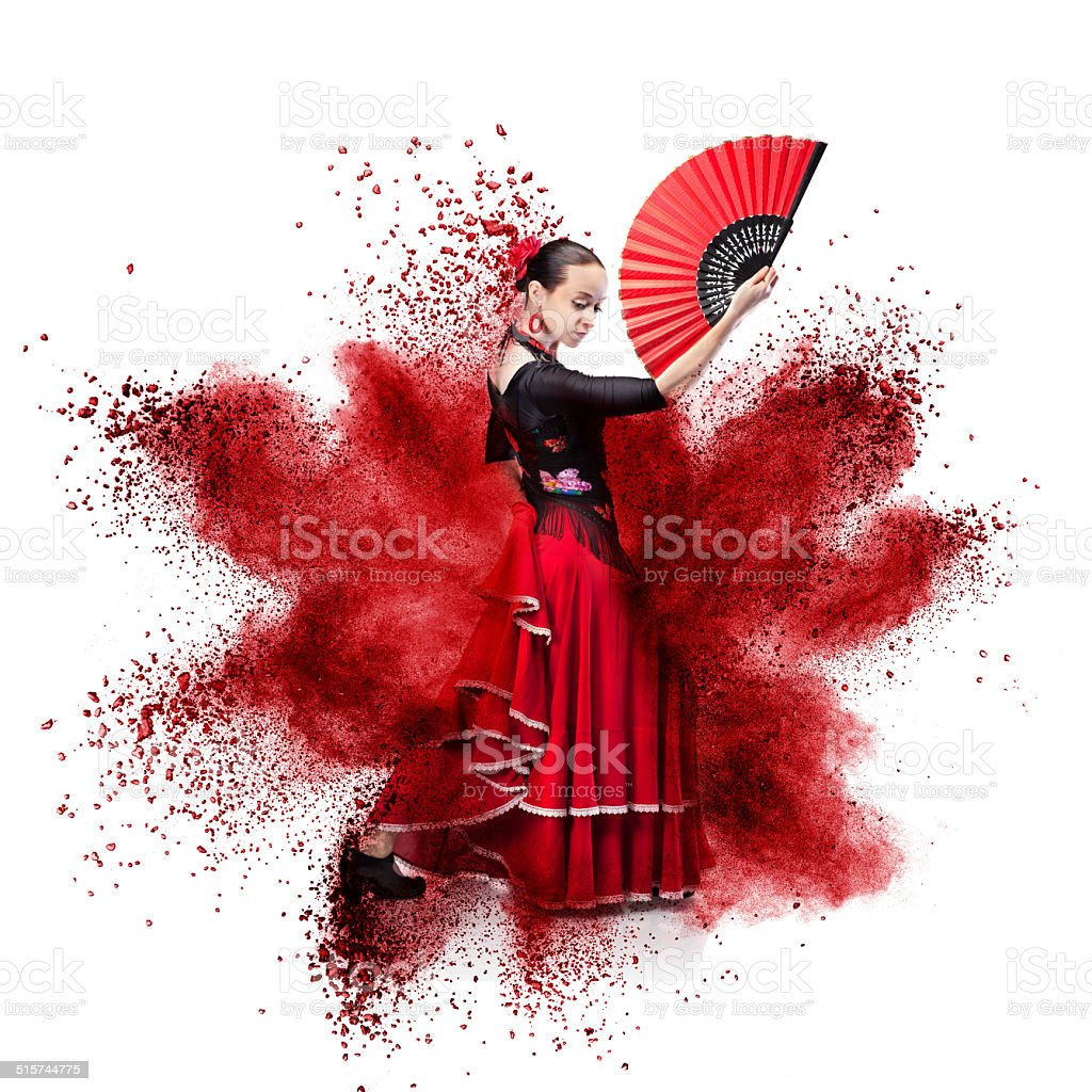 young woman dancing flamenco against red explosion stock photo