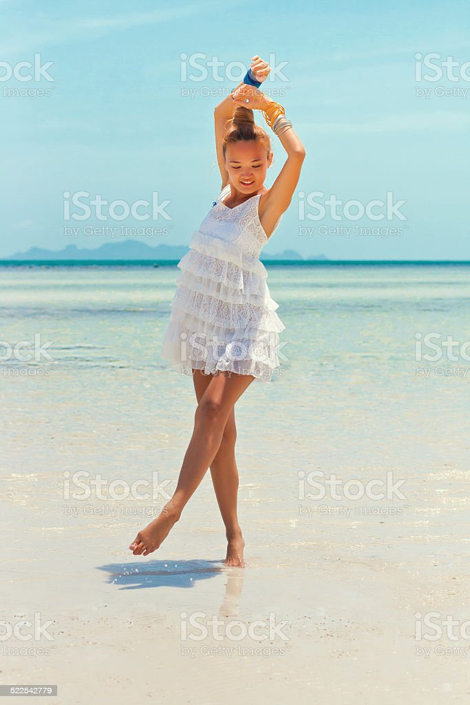 Young woman dancing in the sea stock photo