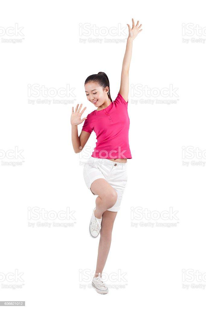 Young woman dancing,smiling stock photo