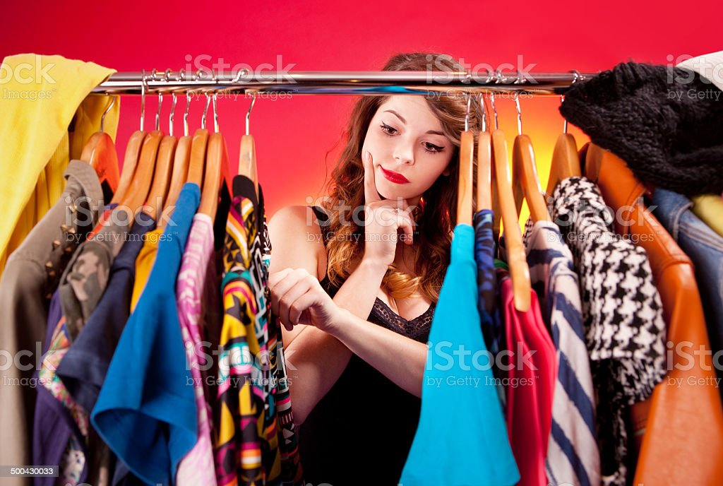 Young woman deciding what to put on stock photo