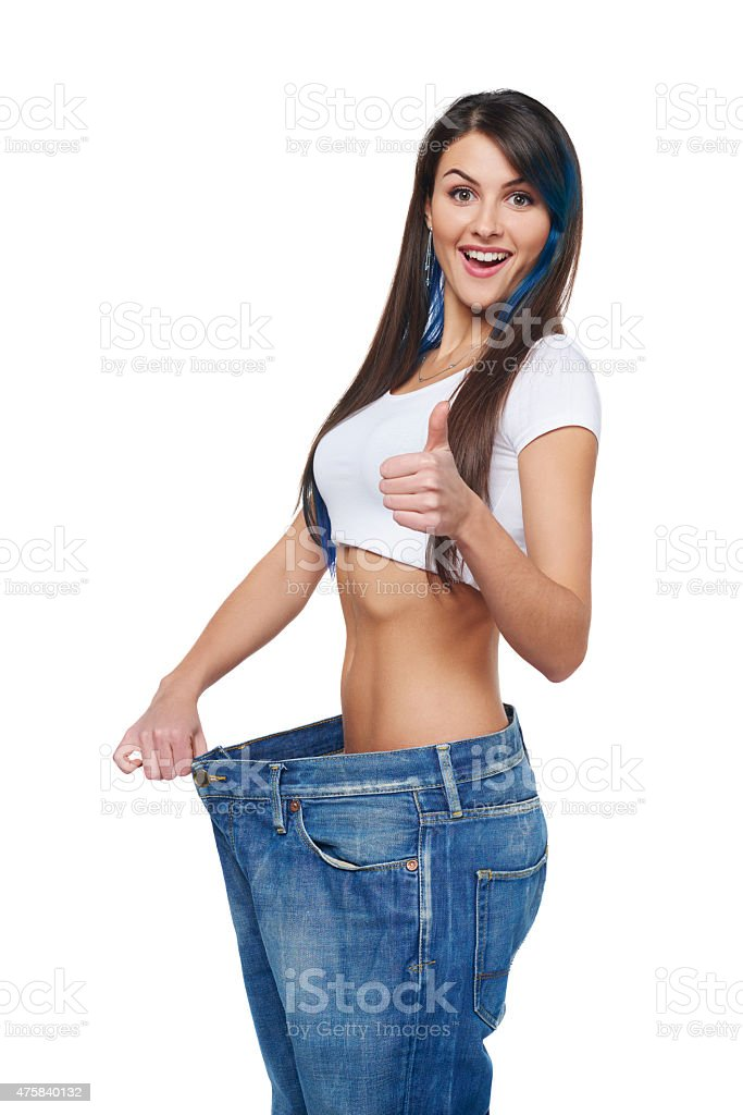 Young woman delighted with her dieting results stock photo